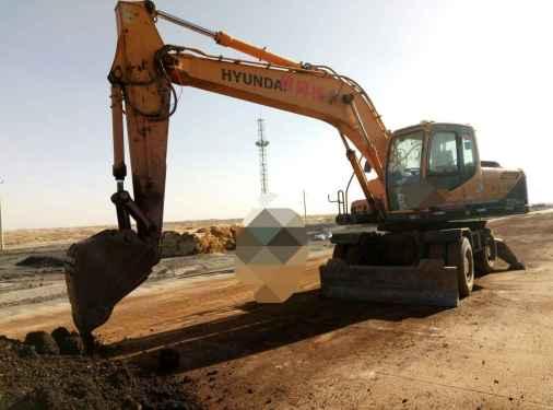 宁夏出售转让二手7000小时2010年现代轮挖R210W挖掘机