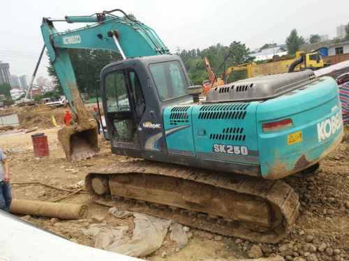 陕西出售转让二手9300小时2010年神钢SK210LC挖掘机